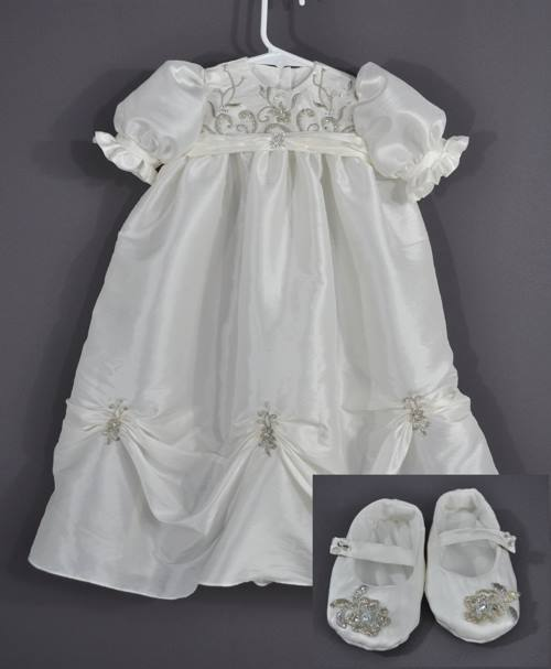 Katrina Bostardi sent her wedding dress to have this baptism gown made for her daughter--complete with booties. Getting a small gown like this to gather right presents an interesting challenge. We originally wanted to make two layers of gathers, but that made the gown way too bulky.