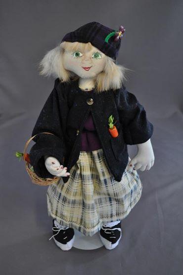 I created this doll for Georganne Baker. It is fashioned after a sketch she sent me and is a mascot doll for a charitable organization.