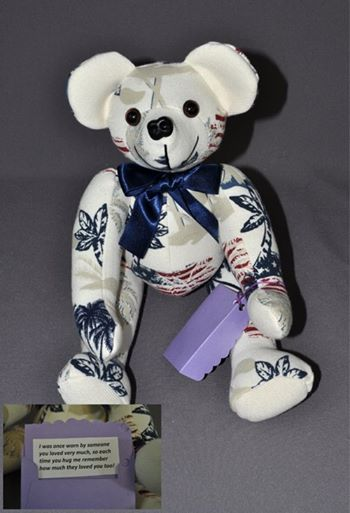 Sandy Romkey sent her late brother's shirt to have a memory bear made and sent to her sister-in-law. She had also included a little note that we mounted on to a piece of card stock and put into a matching mini envelope that we attached to the bear's paw.