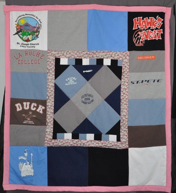 LuAnn Pasquarello sent a variety of t-shirts and sweat shirts to have these two memory quilts made as Christmas gifts this year. I tried to mix the block sizes a bit and added an accent color to help all the different shirt elements come together cohesively.