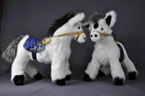 Debora sent her rabbit fur coat to have these two ponies made for her kids.