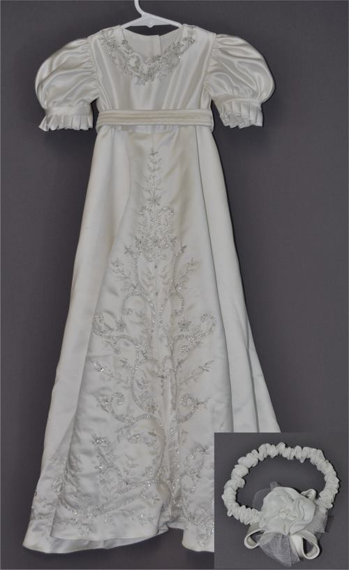 Ashley Roseman sent her wedding dress to have a christening gown made for her daughter. Her dress was made of heavy satin and had lovely embroidery and bead work. We tried to capture the spirit of the original dress.