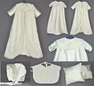 """Vicki sent her daughter's wedding dress to have an outfit made for her granddaughter's baptism. The dress was covered in beautiful lace and bead work. Vicki wanted an outfit that could be worn by either a boy or a girl so we suggested a unisex gown with a ceremonial robe. That allowed us to take full advantage of all the lace and bead work. The Unisex gown is our """"Bishop"""" style with an ornate bib collar and pleats running down the front. The robe has longer sleeves and has the lace/bead work running down the front and circling the hem. We also made a unisex bonnet and a bib to go with the outfit. There was just enough scrap fabric left for two 14"""" pillow shams."""