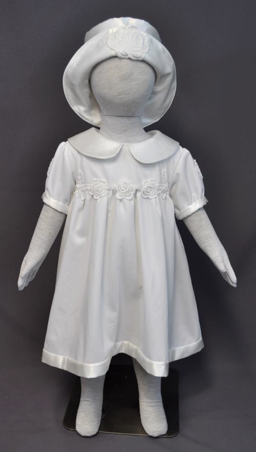 Pam Werner sent her wedding dress from 1977 to have an outfit made for her granddaughter. Since her granddaughter was nearly a year old, we went with a shorter dress that would allow her to walk and finished the outfit with a cute little hat.