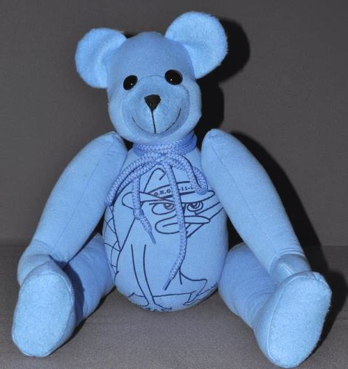 Deb wanted a special bear made for her daughter's birthday. She sent two sweatshirts with the same graphic on them. We were able to make an applique from the graphic and put it right across the tummy of the bear.