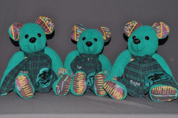 Joyce sent me a terry cloth robe, a pair of sweat pants and a shirt. They all belonged to a good friend who passed away. She wanted bears made for her friend's wife and two children. The mix of fabrics made for very bright bears.