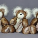 Can't resist sharing this photos. Katherine had a mink stole and a white fox piece and the combination made for three very cute bears.