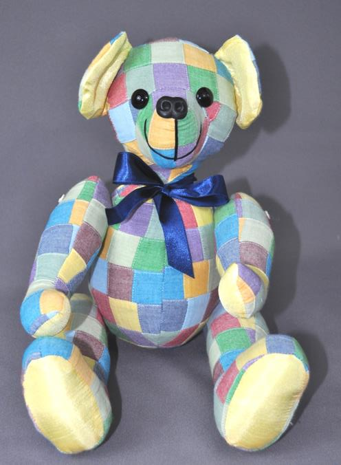 Kathy had received a memory bear in the past and wanted one to remember a good friend. She sent a pretty patchwork shirt that was once her friend's to make this pretty bear from.