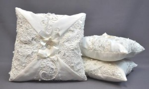Sometimes people want to use their wedding dress for a variety of future special occasions and one of our more popular items is ring pillows. Kelli had us make three ring pillows from her wedding dress.